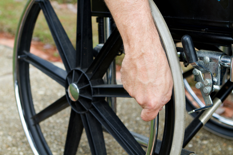 Hand on Wheelchair - Workers Comp Injury